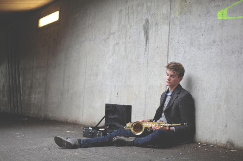 Man sitting down with his passion, the saxophone